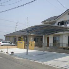 青い空に映える黄色の門塀 NO.37の施工写真1