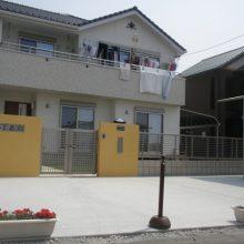 青い空に映える黄色の門塀 NO.37の施工写真メイン